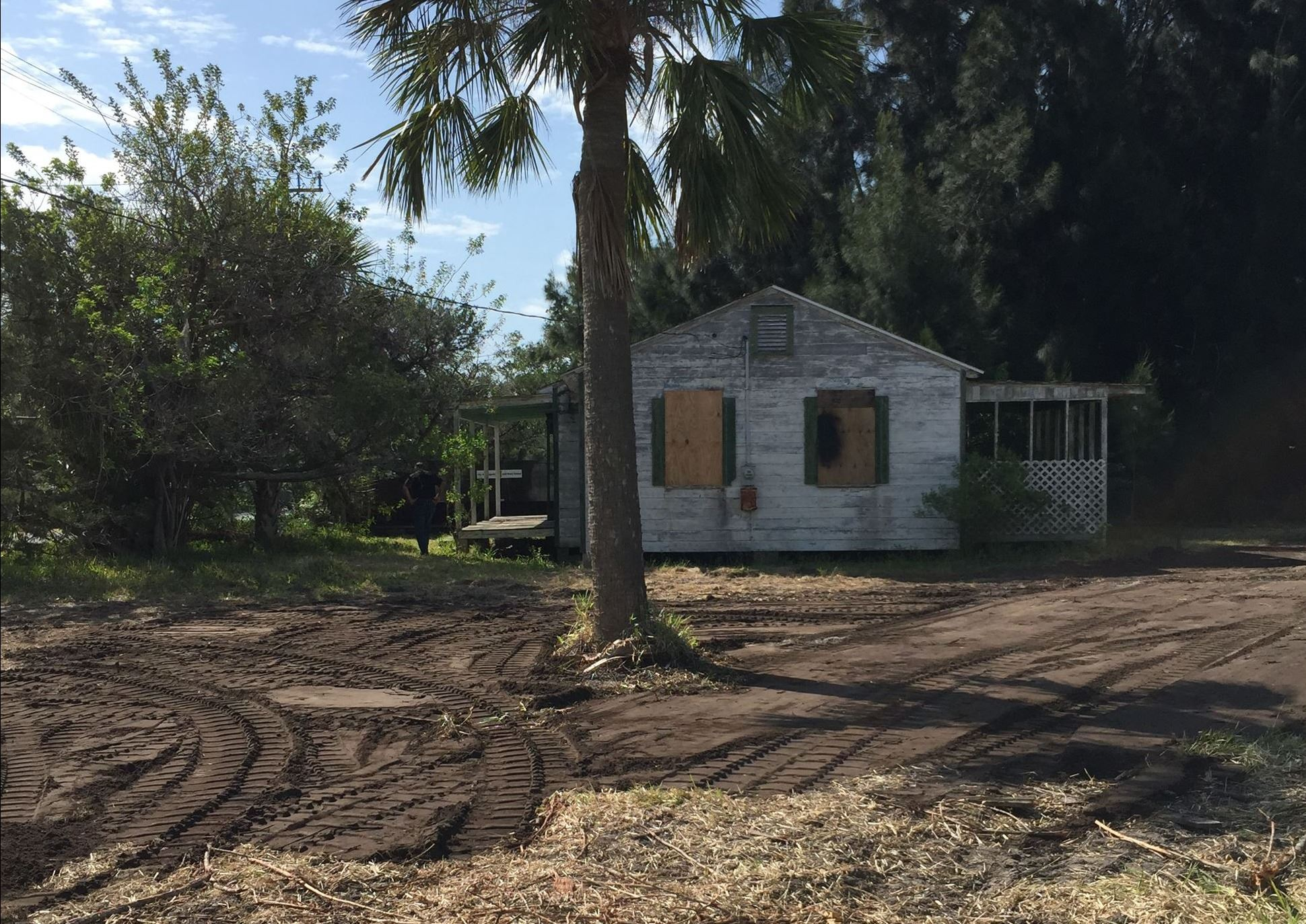 This image is of the cottage and surrounding area with dirt
