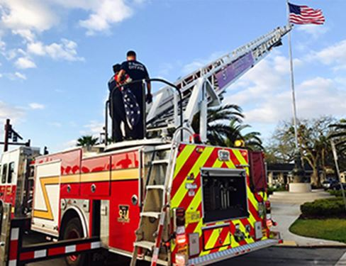 Fire Fighters changing a USA Flag