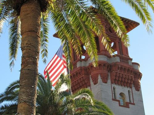 Lightner Tower with palm tree and American flag