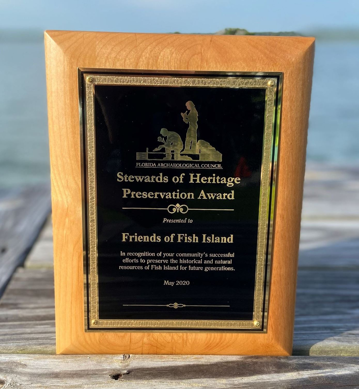 save fish island plaque