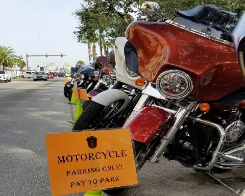 motorcycle parking sign, motorcycles parked