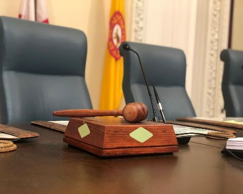 City Commission gavel with chairs