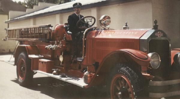 Old Fire Engine with Fire Fighter driving